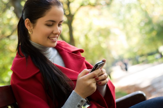 Woman reading mobile device istock